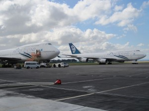 Some 747s, parked outside the hangar